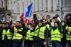 People march on January 5, in La Rochelle during a demonstration called by the yellow vests movement for the eighth week in a row of nationwide protest against high cost of living, government tax reforms and for more 'social and economic justice'. AFP