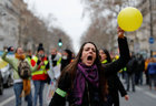 A protester holds a balloon as she takes part in a demonstration by the 'Women's yellow vests' movement in Paris, France, January 6. Reuters