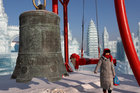 A visitor walks around ice sculptures during the annual ice festival in Harbin, Heilongjiang province, China January 7. Reuters