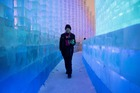 A visitor walks through ice sculptures during the annual Harbin Ice and Snow Festival in Harbin, in China's northeast Heilongjiang province on January 7. AFP