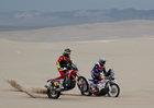 Dakar Rally - 2019 Peru Dakar Rally - First stage from Lima to Pisco, Peru - January 7, 2019 Monster Energy Hondas Joan Barreda passes HT Rally Raid Husqvarnas Carlos Gracida. — Reuters