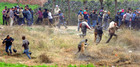 Bystanders run for cover as a leopard enters fields at Lamma Pind in Jalandhar on Thursday. Tribune photo: Malkiat Singh