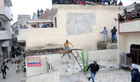A leopard jumps off a wall after being cornered at Lamma Pind in Jalandhar on Thursday. Tribune photo: Malkiat Singh