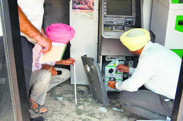 Thieves cut open ATM, flee with  Rs 12.61 lakh