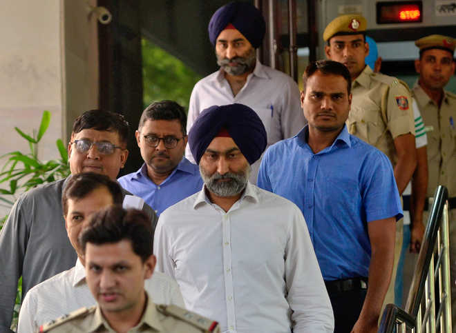 Religare case: Delhi court extends police custody of Singh brothers by 2 days