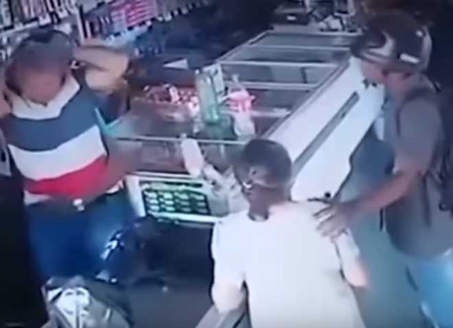 Armed thief refuses cash from elderly lady, kisses her forehead; watch video