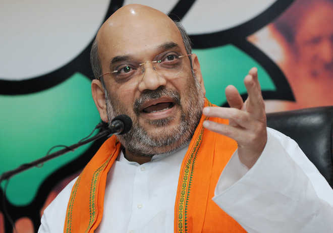 Shah dares Rahul to declare Cong will restore Art 370 in J-K