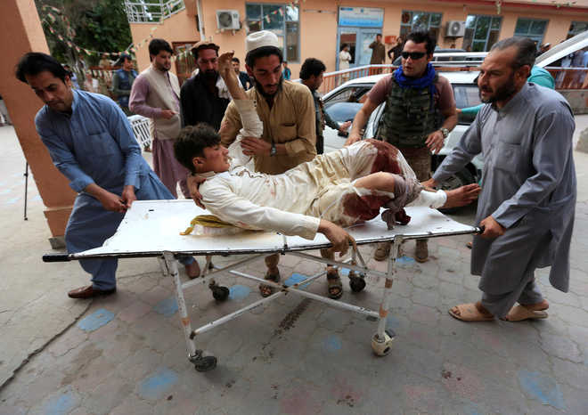 Afghans search for bodies after at least 69 killed in mosque explosions