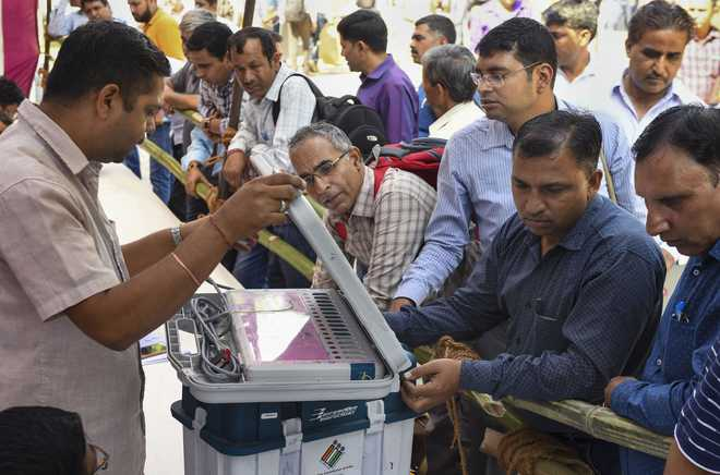 BJP looks to retain power, Cong eyes comeback as Haryana votes on Monday