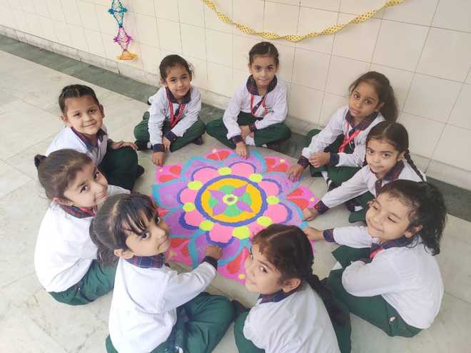 Students welcome festival of lights with rangolis