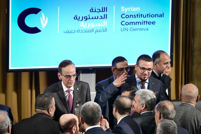 Syria government hits at 'occupation', opposition urges justice as peace panel opens