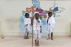 Students dressed like Mahatma Gandhi gather during an event at a school in Chennai on October 2, 2019, to mark Gandhi's 150th birth anniversary. — AFP