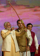 Prime Minister Narendra Modi prepares to shoot an arrow towards the effigy of demon-king of Ravana while attending Dussehra celebrations of Dwarka Sri Ram Leela Society on Vijayadashami, otherwise known as the Hindu festival of Dusshera, in New Delhi on October 8, 2019. PTI photo