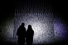 People stand in front of an installation during a light festival in Prague, Czech Republic on October 10, 2019. — Reuters