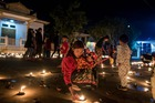 Buddhist devotees light candles at a pagoda during the Thadingyut festival in Kalaw of in the south of Shan state on October 13, 2019. — AFP