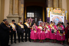Preste organisers of the Morenda Nueva Generation fraternity stand outside San Sebastian Church during the opening of a preste celebration in La Paz, Bolivia. — Reuters