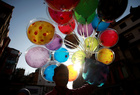 A street vendor sells colourful balloons along the street of Ashon in central Kathmandu ahead of Tihar festival, also called Diwali in Kathmandu, Nepal on October 22, 2019. — Reuters