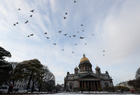 Birds fly over the Saint Isaacs Cathedral in Saint Petersburg, Russia on October 29, 2019. — Reuters