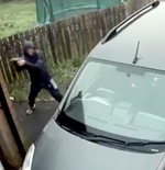Thief throws brick at car, it bounces back, hits him, internet calls it 'karma'