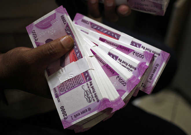 Rupee slips 30 paise to 71.27 against USD as Moody's cuts India rating outlook to negative