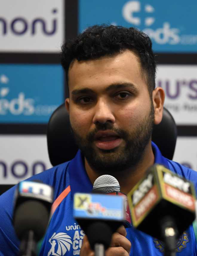 Don't need muscles to hit sixes, even you can do that, Rohit Sharma tells Chahal