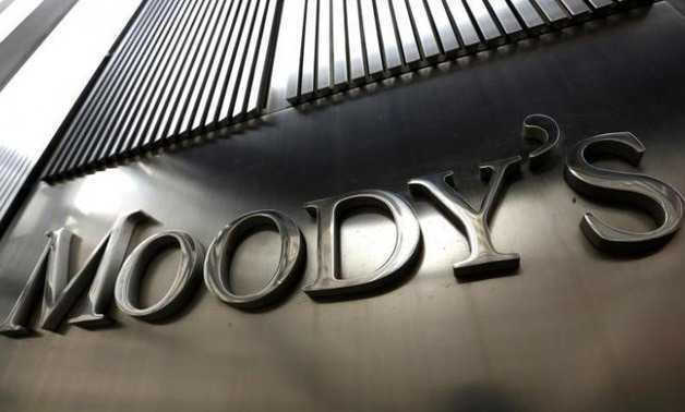 Moody's cuts credit rating to negative