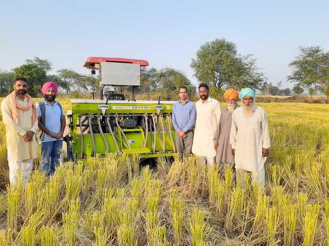 Farmers plough stubble back to improve soil health