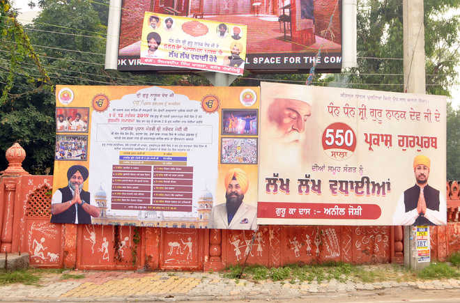 Problem for MC as political hoardings deface city walls