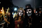 People in costumes participate in the annual Village Halloween parade on Sixth Avenue on October 31, 2019 in New York. — AFP