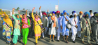 There, finally: Pilgrims from India raise slogans as they arrive at Gurdwara Darbar Sahib in Kartarpur. Hundreds of devotees made a historic pilgrimage to Pakistan on Saturday when the Kartarpur corridor opened. Photos: AFP, PTI and Reuters