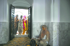 Window of opportunity: Women queue up at the shrine.