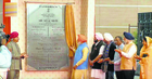 All for one: PM Narendra Modi unveils a plaque to mark the inauguration of the check-post of Kartarpur corridor, as various dignitaries look on.
