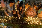 Devotees perform a ritual by lighting diyas on the occasion of Karthika or Kartik month in Hyderabad, on November 12, 2019. — AFP