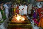 Heir of Sai Geetha Ashram, Srikeerthima, performs a ritual by lighting diyas along with devotees on the occasion of Karthika or Kartik month in Hyderabad, on November 12, 2019. — AFP