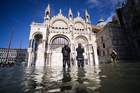 A general view shows the flooded St. Marks Square, with St. Marks Basilica on November 14, 2019 in Venice. — AFP