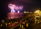 People walk along the malecon watching the fireworks as part of the celebration of the 500 years of the city in Havana, Cuba on November 15, 2019. — PTI
