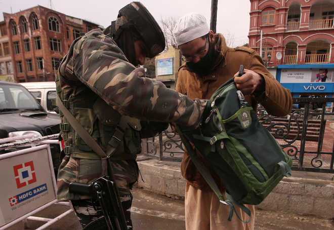 In Kashmir, uneasy calm after ...