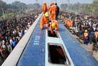 Rescue workers look for survivors after a passenger train derailed near Sahadai Buzurg railway station in the eastern state of Bihar, February 3. Reuters