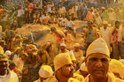 Devotees daubed in turmeric powder watch a procession at shepherd god Khandoba's temple during Somvati Amavasya in Jejuri, February 4. Reuters