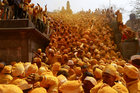 Devotees throw turmeric powder as an offering to the shepherd god Khandoba as others carry a palanquin during Somvati Amavasya at a temple in Jejuri, February 4. Reuters