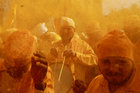 Devotees throw turmeric powder as an offering to the shepherd god Khandoba at a temple in Jejuri, February 4. Reuters