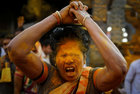 A devotee daubed in turmeric powder goes into a trance before a procession at shepherd god Khandoba's temple during Somvati Amavasya in Jejuri, February 4. Reuters