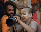 Sadhus shoot on a DSLR camera on a bank of Ganga river during the ongoing Kumbh Mela festival, in Allahabad. PTI