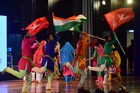 Artists perform with holding tri-colour flag during the inauguration of Jammu Mahotsav 2019 in Jammu on Friday. Tribune Photo: Inderjeet Singh.