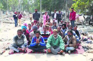 Typists, vend owners sit on dharna