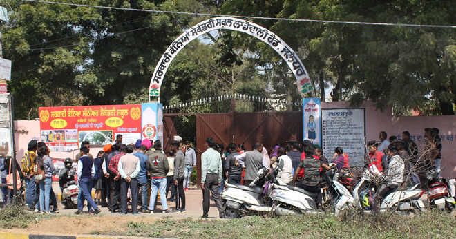 Parents gather outside exam centres in district