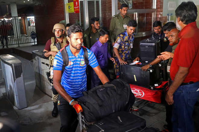 Traumatised Bangladesh cricket team returns home