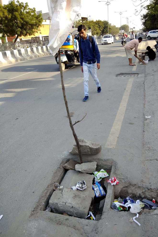 Damaged, open manholes a threat to city residents