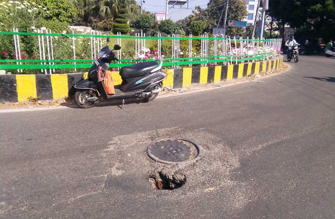 Gaping holes on city roads risk commuters' lives