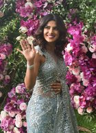 Bollywood actor Priyanka Chopra poses for photos as she arrives for the wedding ceremony of Akash Ambani, son of the Chairman of Reliance Industries Mukesh Ambani at Bandra-Kurla Complex in Mumbai on March 9, 2019. PTI
